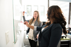 Women collaborating on a whiteboard