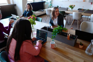 Women collaborating at a long desk