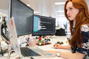 Women developer in front of computers