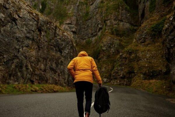 Man walking up a hill